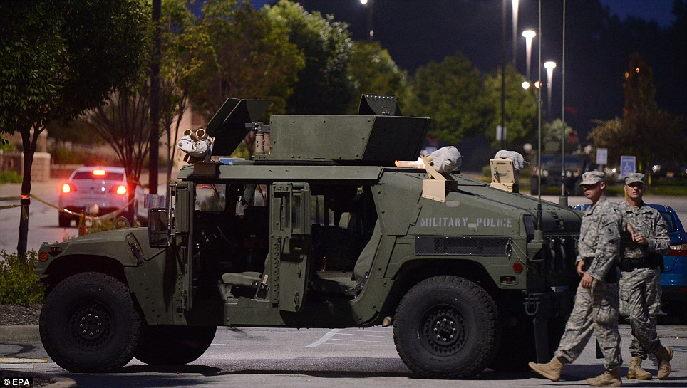 The Missouri National guard patrols a police command center on West Florissant Avenue in Ferguson, Missouri