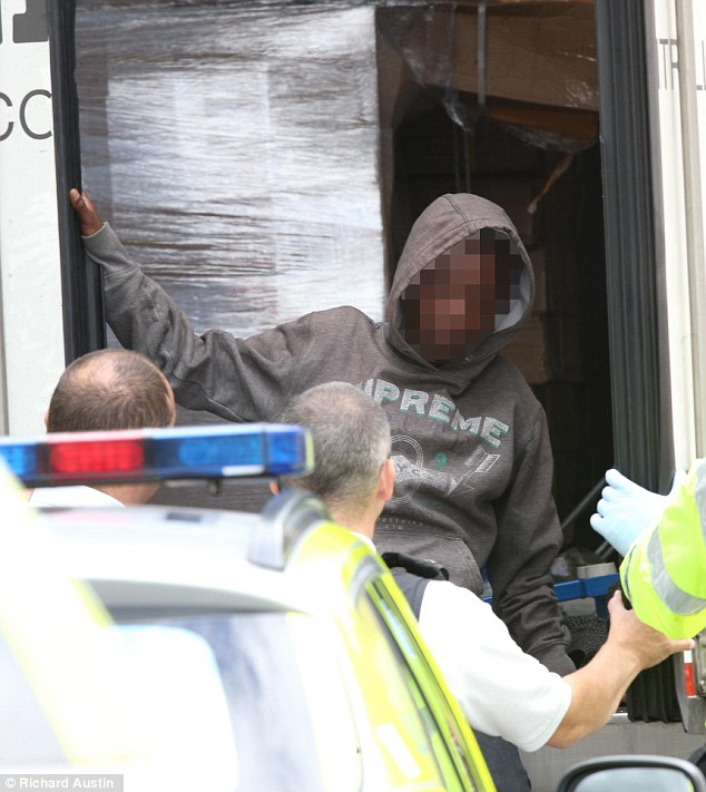 A man has been arrested on suspicion of people smuggling after a lorry containing 15 immigrants - including a 15-year-old boy - from Eritrea and Kashmir suffering from dehydration were found at a service station in Ilminster