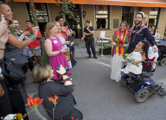 Support: Well-wishers stop to share the moment with the couple as they and the Imam emerge after the wedding