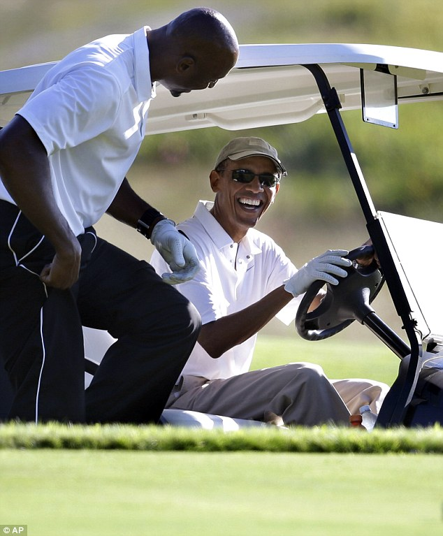 Ex-NBA basketball player Alonzo Mourning (left) also joined the president out on the Vineyard Golf Club course