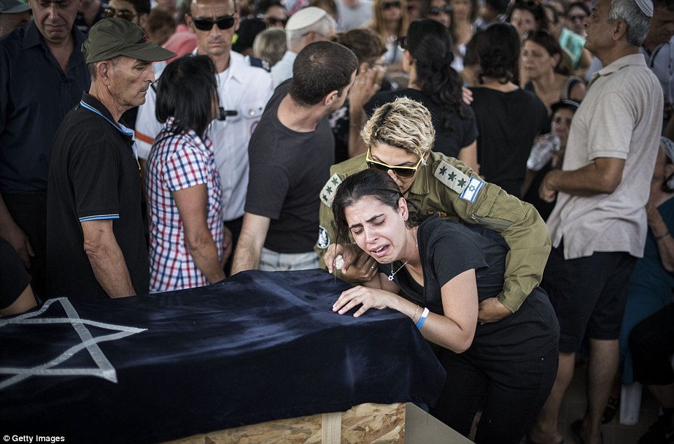 Mouring: Family members grieve for the youngster, who was the first Israeli casualty since the collapse of the temporary ceasefire between Israel and Hamas