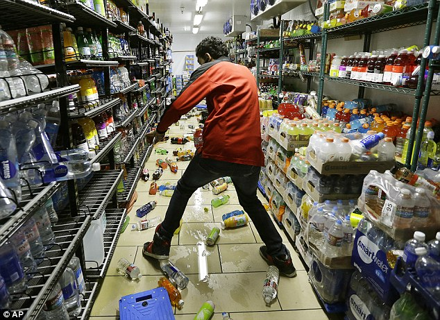 The earthquake left several grocery stores in disarray. Above, Gurbeer Singh cleans up merchandise which fell on the floor at a 7-Eleven in American Canyon