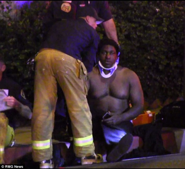 Treatment: Another victim is fitted with a neck brace following the dramatic shooting
