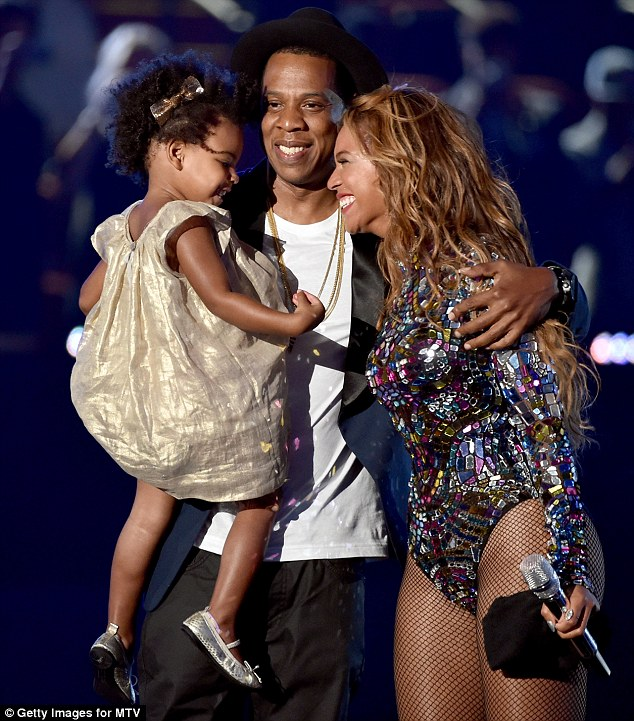 Trio: The couple put on a loved-up display on stage while accompanied by the two-year-old
