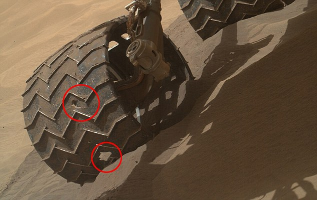 Before and after images of Nasa's Mars rover have revealed the damage it is taking. But experts from the Washington DC agency say it's not a problem - yet. In the images holes on Curiosity's wheels can clearly be seen (pictured). The aluminium wheels have been pierced by driving over sharp rocks