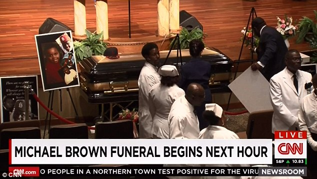 Funeral: Family, friends and high profile supporters including Jesse Jackson and Spike Lee arrive at the funeral of Michael Brown on Monday