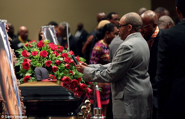 Supporters: Spike Lee is seen inside the church next to Michael Brown's coffin