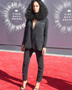 Downplaying it: Solange Knowles opted for a shimmery suit and black strappy high heels along with blue nail polish