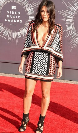 Versatile fashion: Kim Kardashian, who was presenting at the VMAs, wore a deep-cut patterned number that looked similar to the more modestly worn one on Joan Smalls