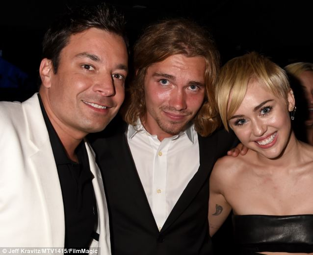 VMA host Jimmy Fallon, Jesse and Miley Cyrus pose after the show at The Forum, Inglewood, California