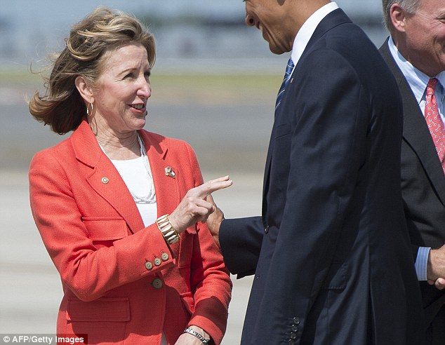 Nuclear: Democratic Sen. Kay Hagan (L) is in the fight of her life in North Carolina, and greeted Obama at the airport but DIDN'T appear on stage with him