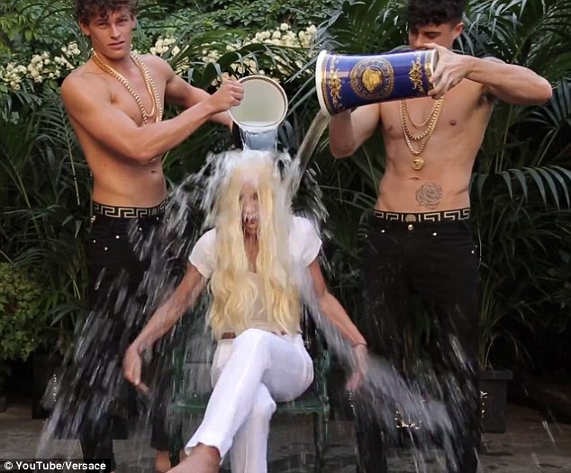 white bucket chair cosco kitchen stool donatella versace doused in freezing water by topless men for als ice challenge | daily ...