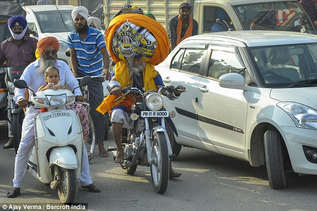 Wide load: The size of Mr Mauni's turban is even more apparent when he's alongside other Sikhs