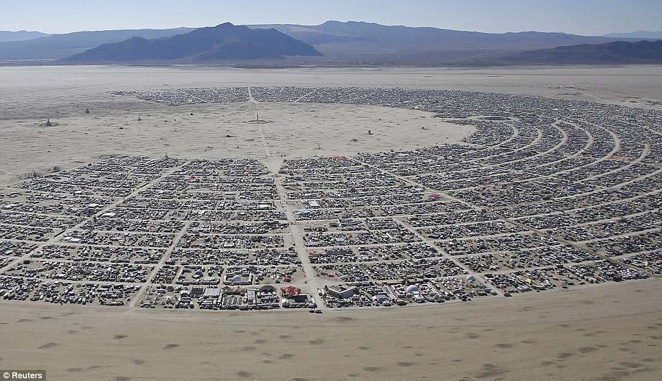 City in the desert: An aerial view of the Burning Man festival reveals the true scope of the event. Up to 70,000 people from all over the world have gathered at the sold out festival to spend a week in the remote desert cut off from much of the outside world to experience art, music and the unique community that develops