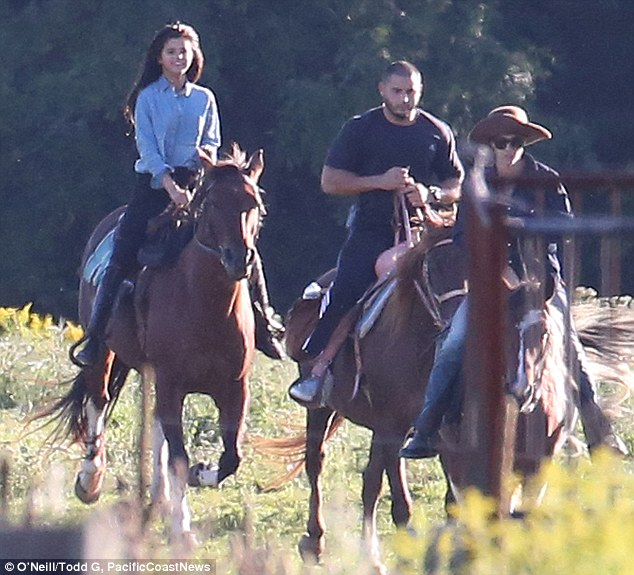 Rising into the sunset: Justin Bieber went full cowboy as he donned a Stetson to take Selena Gomez for a horseback ride in his native Canada on Wednesday
