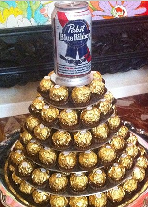 Ambassador's selection: Matthew Barzun serves guests with a tower of Ferrero Rocher chocolates and lager