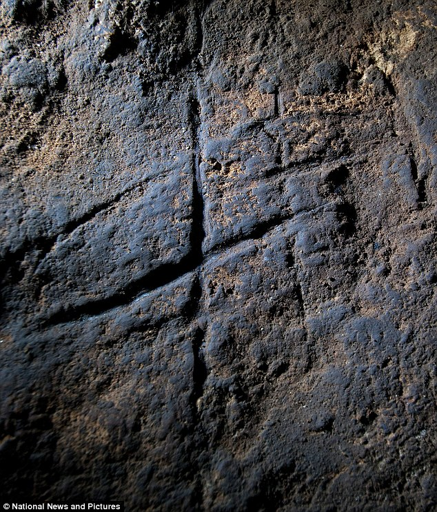 But is it art? Lines scratched into a cave could be proof that Neanderthals were more intelligent and creative than previously thought and some experts claim they are the first known examples of Neanderthal rock art