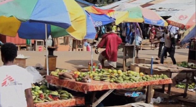Threat: The unidentified man walked into a market in the capital Monrovia - which has been badly hit by the worst ever outbreak of the disease - in order to find something to eat