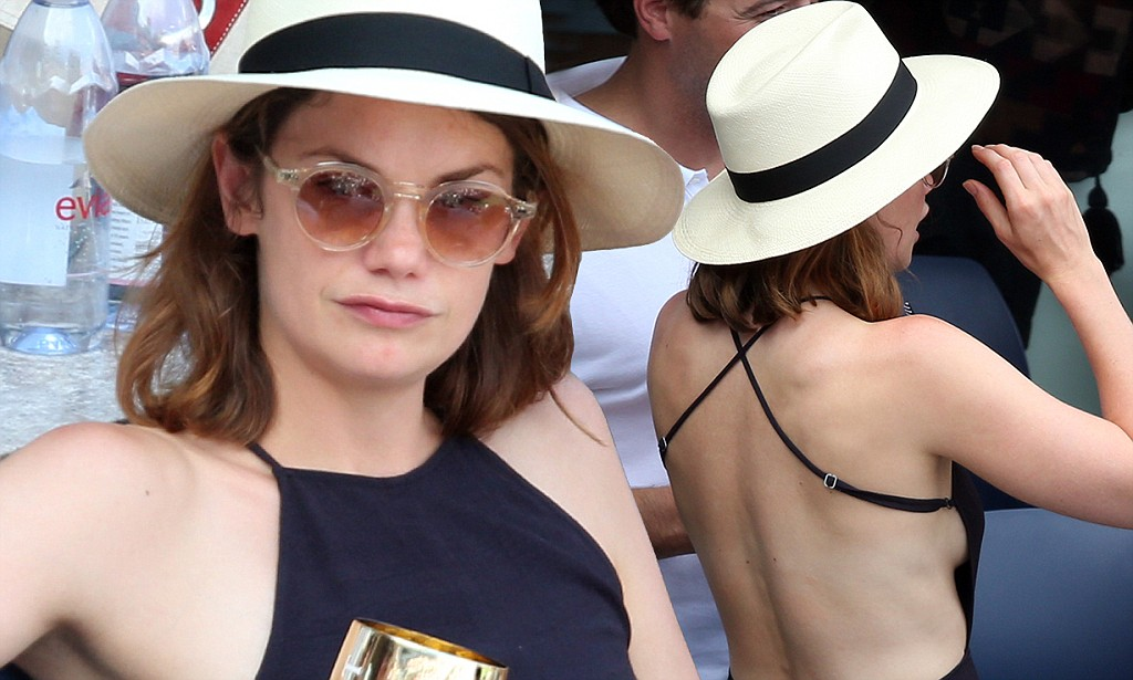 Ruth Wilson flashes a hint of sideboob in a black dress at the US Open Tennis Championships