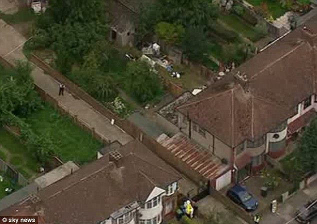 Aerial images show police and forensics officers at the crime scene