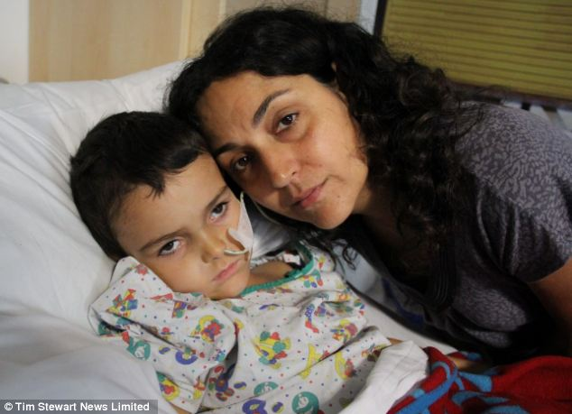 'Overjoyed': Ashya in hospital with his mother Naghmeh. The five-year-old will fly by private jet to a specialist hospital in Prague as soon as possible to start a course of proton beam therapy
