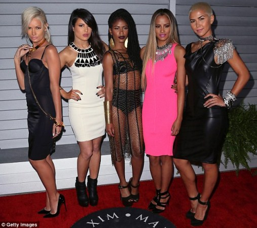 Star: Battle, pictured center, was a member of the girl group G.R.L. From left: Lauren Bennett, Natasha Slayton, Battle,   Emmalyn Estrada and Paula von Oppen at the Maxim Hot 100 event in California last June