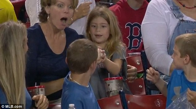 Young charmer Ryan was sitting in the stands at Fenway Park, Boston, when his random act of kindness was caught on camera