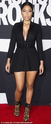 Anaconda: Not to be outdone, Nicki Minaj also flaunted her amazing figure in a plunging little black mini-dress and black and gold embellished shoes