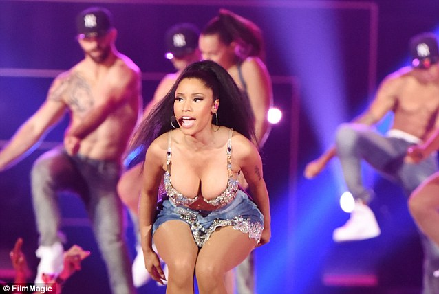 Working it: The Super Bass rapper also showed off other aspects of her voluptuous figure
