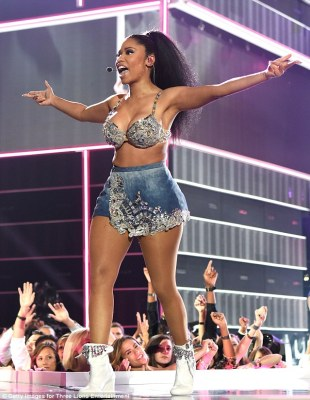 Winning: The pop star got the crowd going as she got them pumped up