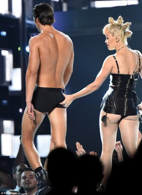 Giving it a squeeze: Ora pinched a male underwear models bottom during her performance
