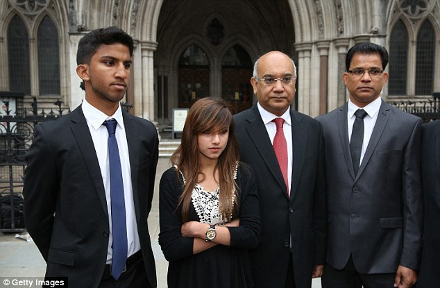 In attendance: Mrs Saldanha's son Junal (left), daughter Lisha, and husband (right) with MP Mr Vaz outside the Royal Courts of Justice