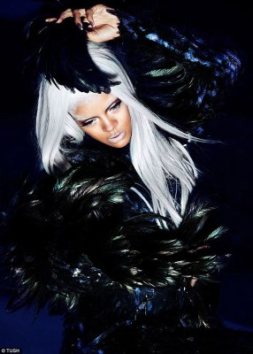 In the dark: The Stay singer wore a feathered getup dramatically contrasting with her silver hair