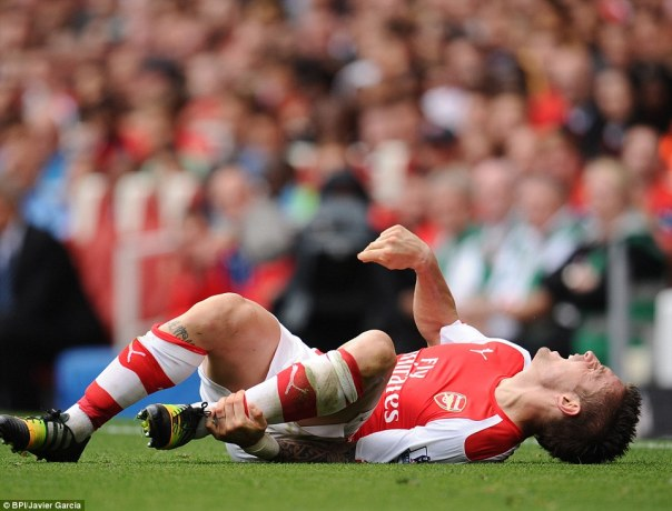 Mathieu Debuchy of Arsenal was carried off on stretcher after suffering what appeared to be a serious leg injury late in the second half