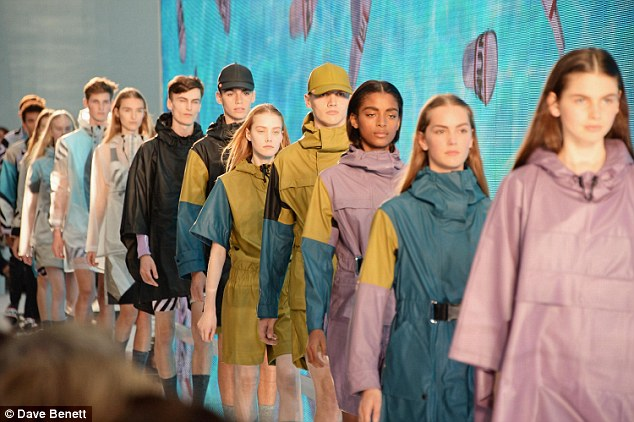Return of the mac: The show featured trendy outerwear, bags and shoes, all perfect for a wet and wild festival