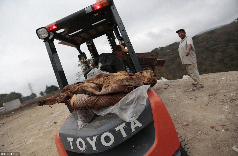 Mummified corpses and plastic bags filled with decomposed remains Guatemalan grave cleaners