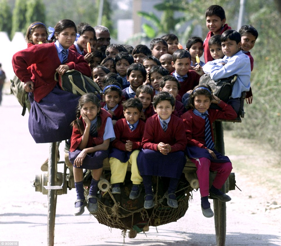 Maximum capacity: A single horse cart ferries more than thirty-five children to school on the outskirts of New Delhi in India