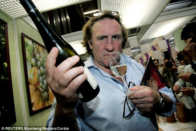 Wine lover: Gerard Depardieu during a visit to the 'Vinexpo' international wine fair in Bordeaux, south-western France in 2005. He runs his own award-winning vineyard in the Medoc