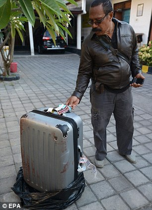 Gruesome: Mrs Mack's body was discovered semi naked stuffed into this suitcase which had been left in the back of a taxi