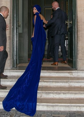 Is it long enough?! A roughly five-foot train trailed along behind her dress, which came off the rosette shoulder detail, creating a dramatic effect as she made her way up the stone staircase