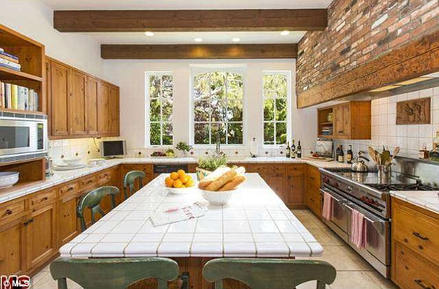 In the mood for food: Brick and tile walls lined the spacious and sunny kitchen