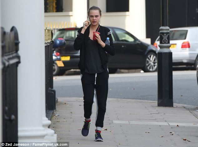 Smoothie operator: Cara looked extremely different while stepping out in London for a smoothie on Monday