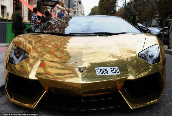Car enthusiasts have filmed the gold plated vehicle, which features a 6.5-litre V12 engine delivering 692 hp, driving through some of Paris's most exclusive streets