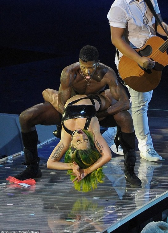 Swinging good time: The pair began to writhe on stage, which didn't stop Gaga from continuing to sing