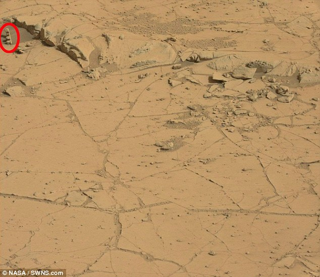 The Curiosity rover has spotted a rock that looks like traffic lights on Mars (shown in the red ring in this image). Washington-based Nasa is yet to comment on the latest discovery. The finding highlights just how weird and wonderful some of the rock formations on Mars can be