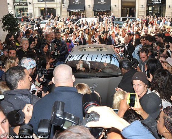 No crowd control: Kim, Kanye and her mother arrived to a scene of chaos at the Balmain show in Paris on Thursday