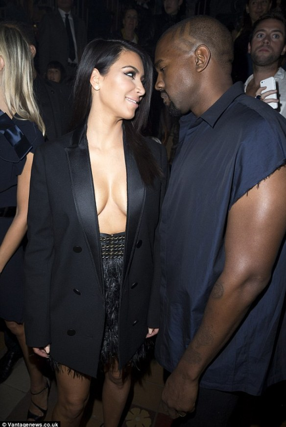 The look of love: Kim couldn't hide her affection as she spoke to Kanye during the fashion fanfare