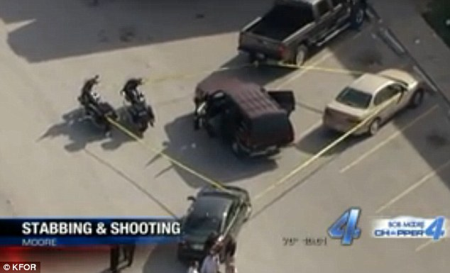 Stopped: Police tape cordons off a black SUV the 30-year-old suspect drove to the store on Thursday