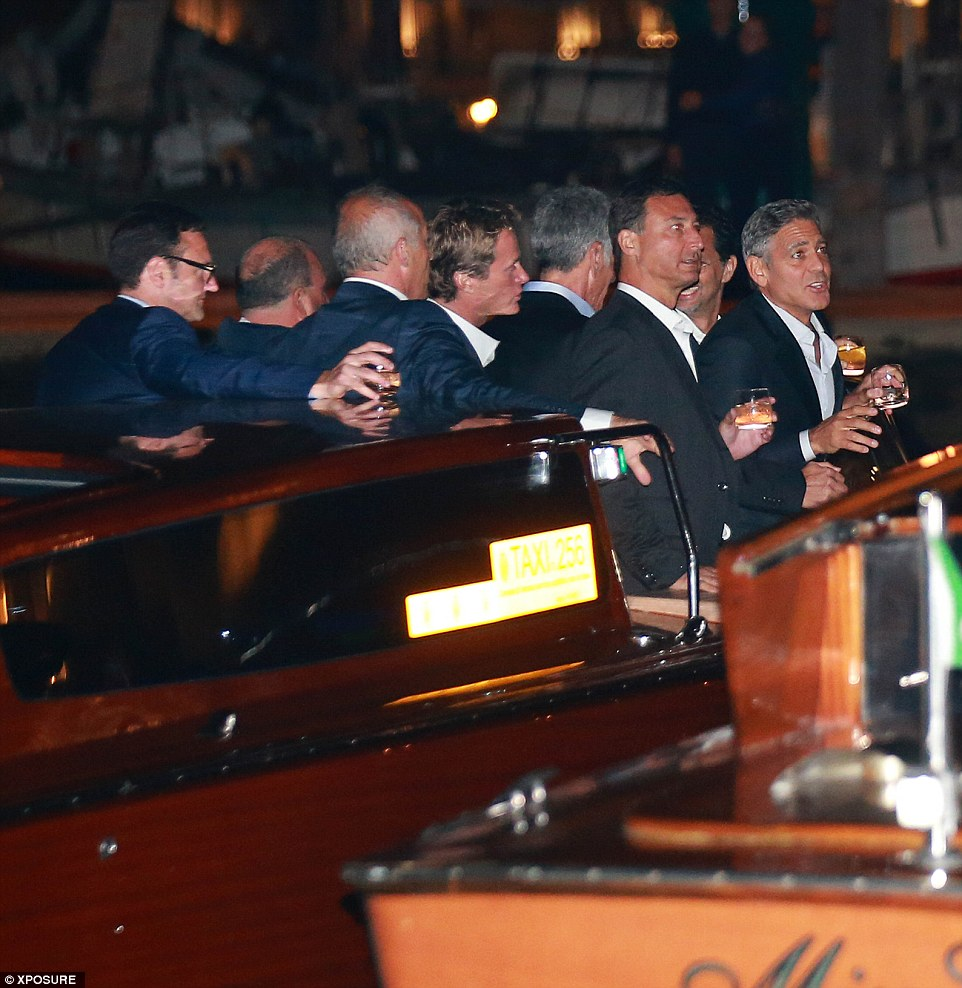 Celebration: George Clooney, his rumoured best man Rande Gerber (centre)  and his groomsmen enjoy some fine liquor after dinner at the exclusive five-star Cipriani Hotel on the nearby island of Giudecci