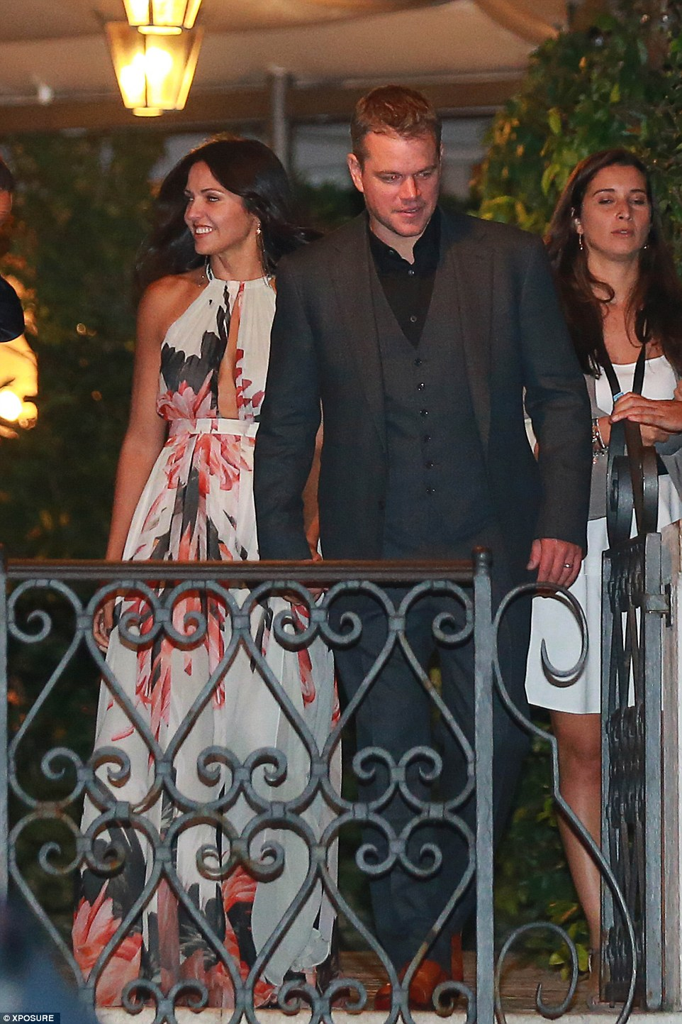 Flower power couple: Matt Damon accompanies his stylish wife Luciana Barroso out of the venue on Friday night